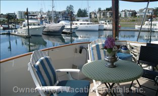 View from Back Deck in Port of Sidney Marina - Covered Dining Outdoors. There is Also a Dining Room and Kitchen Table Indoors.