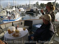 Looking at Boat Activity in Port of Sidney Marina - Enjoy your Meals on the Covered Deck While Viewing the Marina Activity