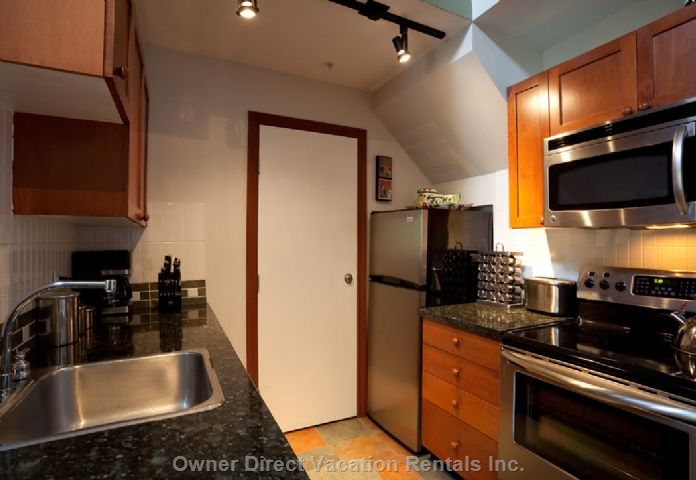 Kitchen with Stainless Steel Appliances & Granite