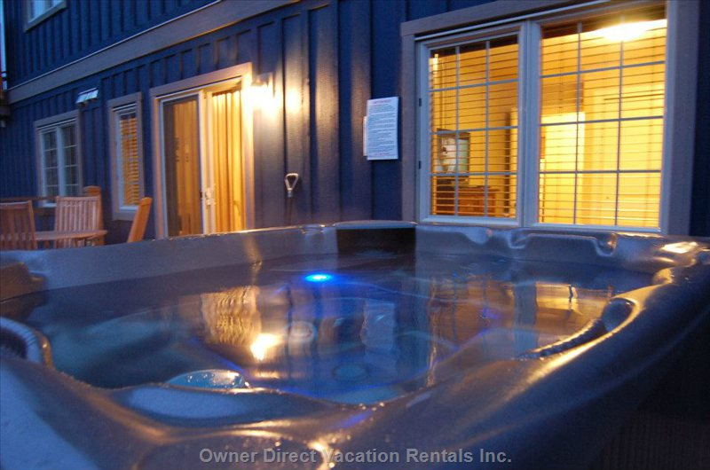 Relax at the Hot Tub Overlooking the Beautiful Mountains