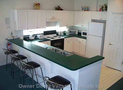 Kitchen with Serving Bar. - everything Required to Prepare a Family Meal, Including Stove, Microwave Oven, Dishwasher and more!