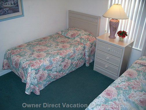 Twin Beds with Cable TV, and Neighboring Full Size Bathroom.