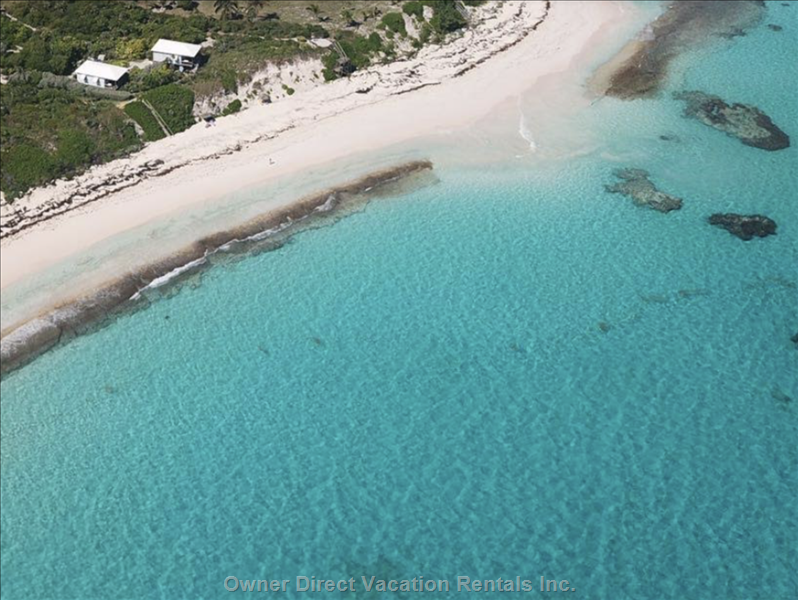 Aerial Shot of our Stunning Deserted Pink Sand Beach with Very few Houses Nearby!