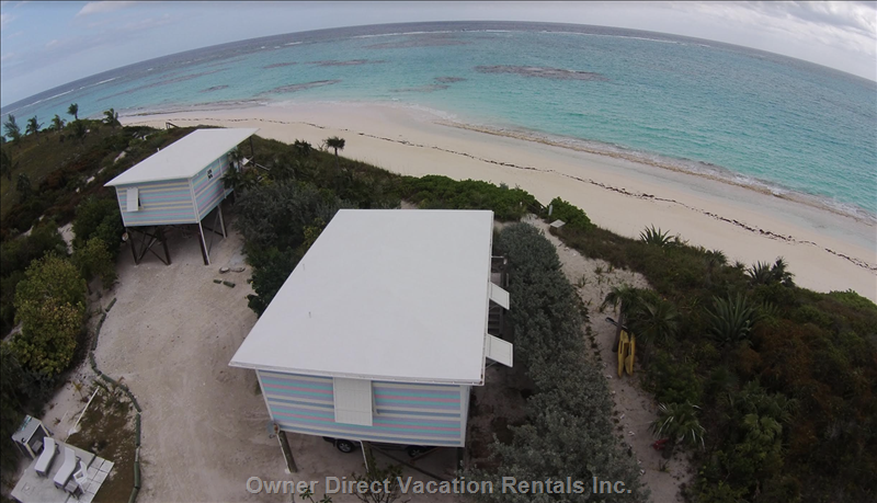 View from above of the Two Identical Island Beachfront Houses Perched on a Sand Dune!