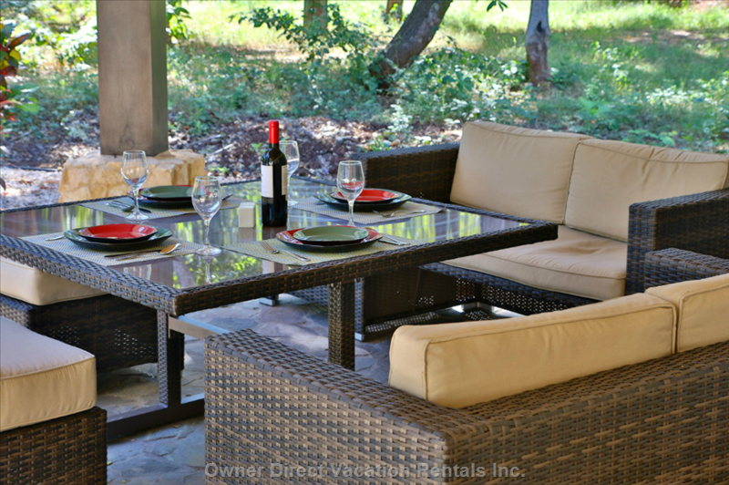 Looking from the Patin Door out onto the Lanai and the Patio Table all Set for Al Fresco Dining!!