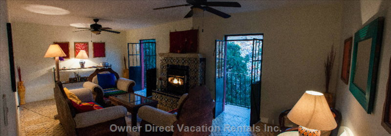 Main Living Space, both Balconies Look out over the City.  A Gas Fireplace Takes the Chill off Cool Winter Nights.