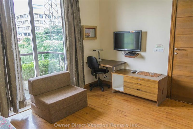 Work Desk, Flat Screen Tv, Sofa and other Amenities Too