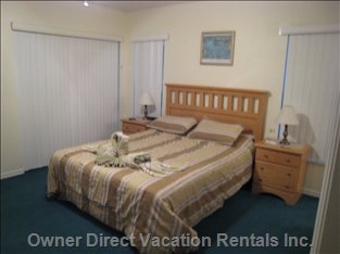 Spacious Master Bedroom - En-suite Facilities, Large Closet, Patio Doors to Lanai and Pool