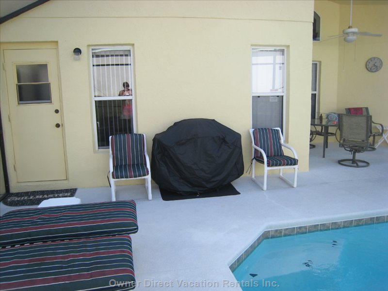 Pool Area - Gas Bbq, Loungers, Chairs, Covered Lanai with Fan, Table & Chairs, Private Pool and Florida Sunshine - what more Could you Want?
