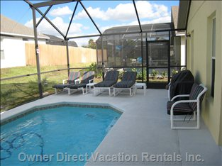 Screened Pool - Large Deck with Loungers. Screened from Bugs. Shrubbery around Exterior for Privacy.