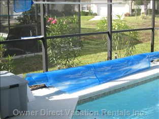 Pool Area - Pool Blanket on Roller System to Preserve Pool Temperature in the Colder Months (Pool Heating Available at Additional Cost)