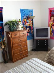 Children`S Bedroom with Ceiling Fan and Tv with Play Station Equipment