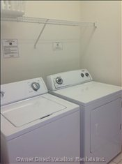 Laundry Room with Washer and Dryer Machines