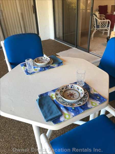 Lanai has Comfy Dining Seating for 4 and 2 Comfy Lounge Chairs with a Small Table in between for Coffee, Wine, Etc.