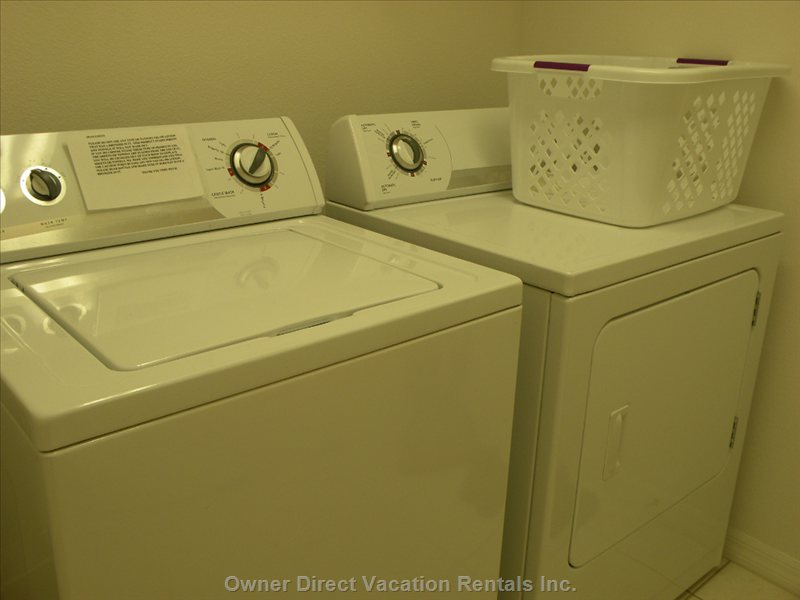 Laundry Room with Washer, Dryer, Laundry Basket, Hoover, Iron and Ironing Board