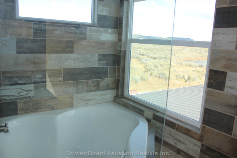 Second Bathroom. Tub with a View of the River.