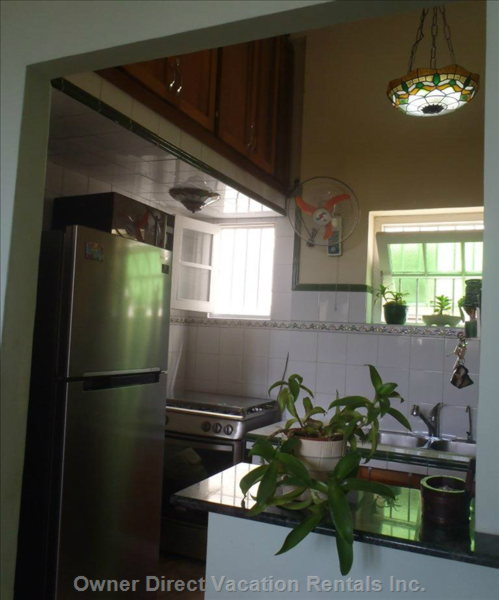 Kitchen has Microwave, Gas Stove with Oven and a Two Doors Refrigerator.