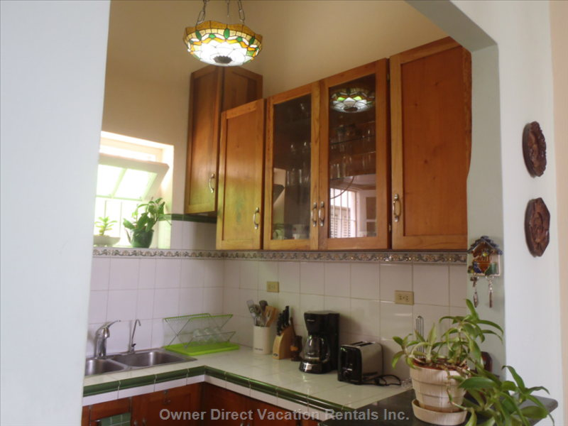 Kitchen Provided with Electric Appliances, Cookware and Dinner Service.