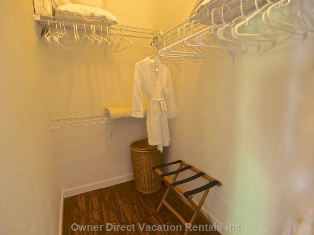 Walk in Closet has Convenient Storage and Bath Robes