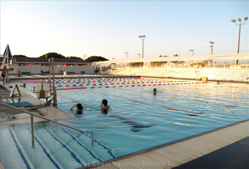 Heated Pool has Lap Pool, Wading Pool, and  Large Swimming Pool Area