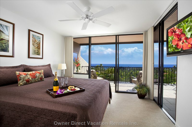 Master Bedroom with Aircon, Ceiling Fan, Flat Screen Tv, Alarm Clock, Music Box and Two Ocean Views.