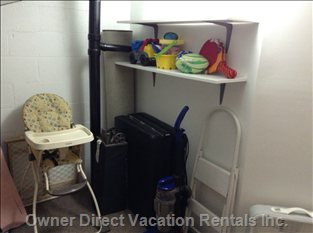 Loft Storage Space with Extra Futon, Pack 'n' Play, Highchair and Assorted Beach Toys