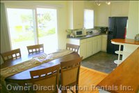 Dining Space and Kitchen, with Direct Access to the Large Walkstreet Patio.