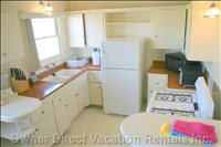 The Fully Stocked Kitchen is Bright and Cheerful, with Ocean Views.