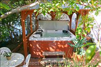 The Lush Interior Courtyard Features a Jacuzzi with Gazebo and Bar.