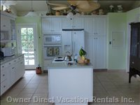 Kitchen from Sunroom - Double Pocket Doors Lead into the Kitchen from the Screened Lanai.