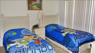 Twin Bedroom #1 Showing the Disney Theme Bedding that is Available If you are Traveling with Small Children