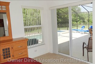 This Photo of the Master Bedroom Shows the View to the Pool Area