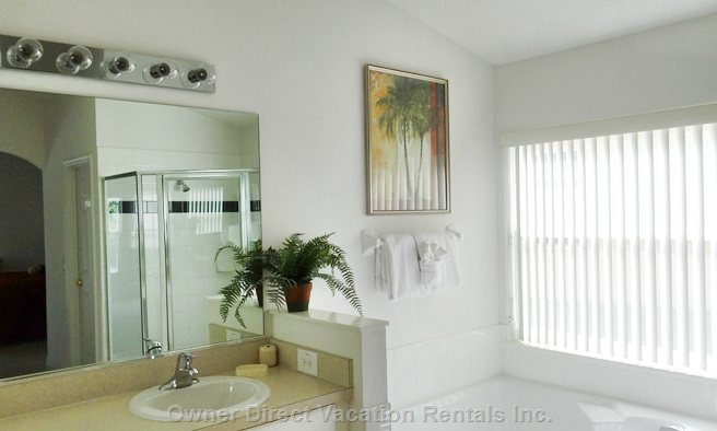 Master Bathroom with Large Tub and Walk in Shower
