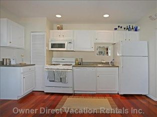 Kitchen - Fully Equipped Kitchen with Dishwasher and Hardwood Floor