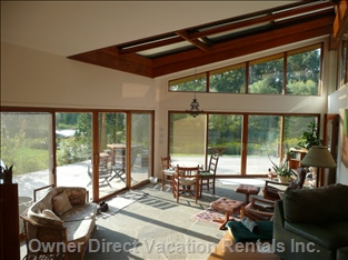 Great Room with Sliding Doors and Full View of Pond and Fields