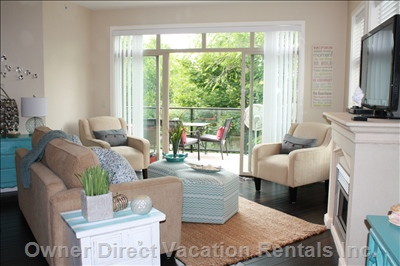 Beautiful Living Area, Comfortable with Beautiful Lighting and Access to Patio