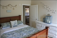 Master Bedroom with Calm Comfortable Decor, Queen Sized Bed and Ajoining Master Bathroom. Walk in Closet and Access to Patio