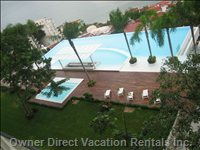 Our 5th Floor View of Outdoor  Heated 40 Meter  Infinity Swimming Pool. Includes a Stockable Swim-up Bar for Entertaining