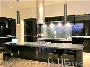 Expansive Bar and Kitchen Allow for Guest and Family to Gather around the Kitchen and Bar