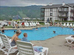 Heated Private Pool - the Pool is is Usually Open from Early June through September. Peak Summer Periods Are Supervised with a Qualified Life Guard. Tremblant Ski Slopes and Pedestrian Village is in the Background a 1 Minute Drive a Or Short Walk Way.