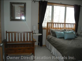 Master Bedroom with Queen Sized Bed, Double Closet, Ensuite and Mountain Views
