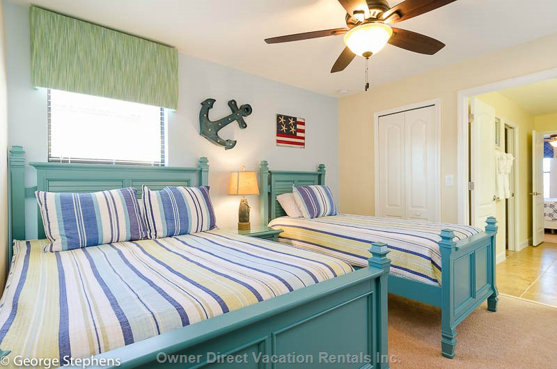 The Anchor Bedroom with one Full and one Twin Bed.