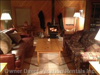 Comfortable Living Room, Drying Wall behind Wood Stove.
