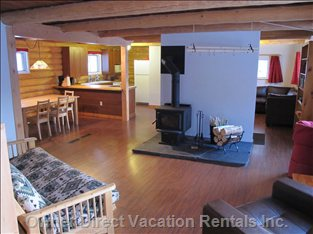 "Open Living Area - the Living Area is Neatly Divided into an Entertainment Area with a 42"" HI-DEF Lcd TV, Cable, a Cd/DVD/Blu-ray Player, a Dining Area, and a Relaxation Area around a Wood Burning Stove. There is Also Wireless Internet."