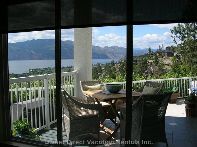 Panoramic Lake , Mountain & Vineyard Views from the Kitchen to Two Private Patios, one Covered and a Huge Sun Patio. South Exposure.