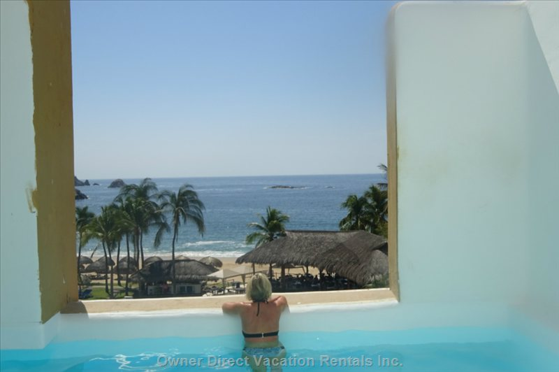 View from inside Pool of Ocean, Beach, Pool and Gardens.  You Could be Here Soon with Reservation Today.