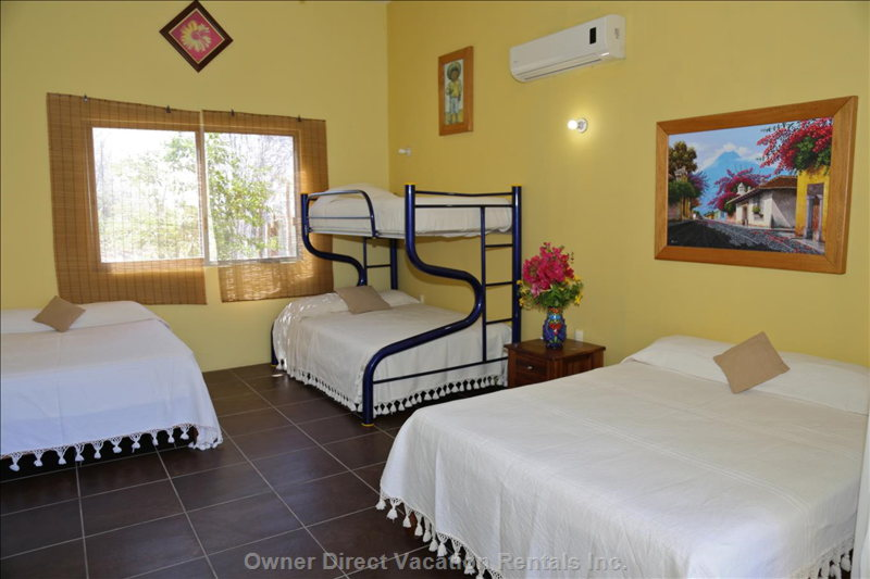 Bedroom Selva on the Palapa Terrace has Two Queen Beds and a Bunkbed.