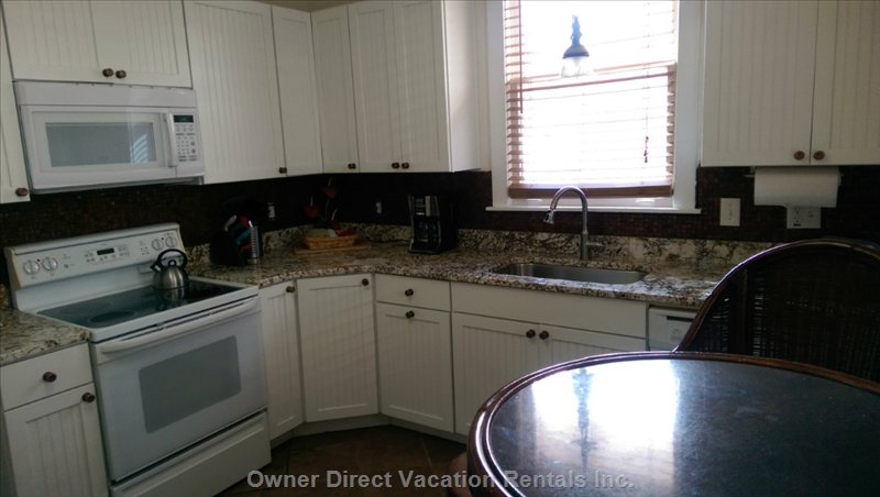 New kitchen...New Cabinets and Granite Counter Tops and Fixtures