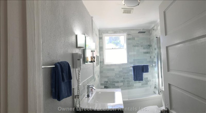 Downstairs Full Bath. Bath has Tub with Shower, Sink and Toilet.