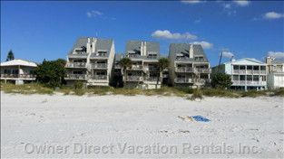 Luxury Townhome-Style Condominium Living Located on the Beach with Sunset Views from Master Bedroom Balcony and Living Room Balcony.